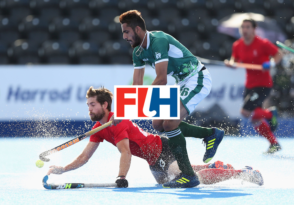 LONDON, ENGLAND - JUNE 16:  Iain Smythe of Canada and Ammad Shakeel of Pakistan battle for the ball during the Hero Hockey World League Semi-Final Pool B match between Pakistan and Canada at Lee Valley Hockey and Tennis Centre on June 16, 2017 in London, England.  (Photo by Alex Morton/Getty Images)