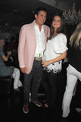 EDWARD TAYLOR and LADY NATASHA RUFUS-ISAACS at a party to launch the new upstairs area of Mamilanji, 107 Kings Road, London SW3 on 19th April 2007.<br />