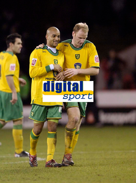 Photo: Jed Wee.<br />Sheffield United v Norwich City. Coca Cola Championship.<br />26/12/2005.<br />Norwich's Leon McKenzie (L) and Gary Doherty celebrate at the final whistle.