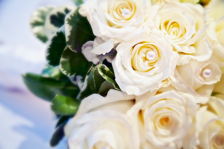 The bride's beautiful wedding bouquet. The flowers (roses) are adorned with pearls. <br /> <br /> To view Katie and Brad's complete Wedding Gallery Collection, visit the Client Area and log-in. You'll be able to view all images as a slideshow, order prints and more.<br /> <br /> &copy; Images of a Promise by Dean Oros Photo + Design