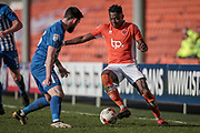 Bright Osavi-Samuel (Blackpool) cuts inside the Hartlepool United player during the EFL Sky Bet League 2 match between Blackpool and Hartlepool United at Bloomfield Road, Blackpool, England on 25 March 2017. Photo by Mark P Doherty.