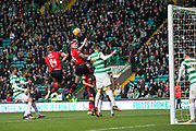 14th October 2017, Celtic Park, Glasgow, Scotland; Scottish Premiership football, Celtic versus Dundee; Dundee's Josh Meekings beats Celtic's Nir Bitton in the air