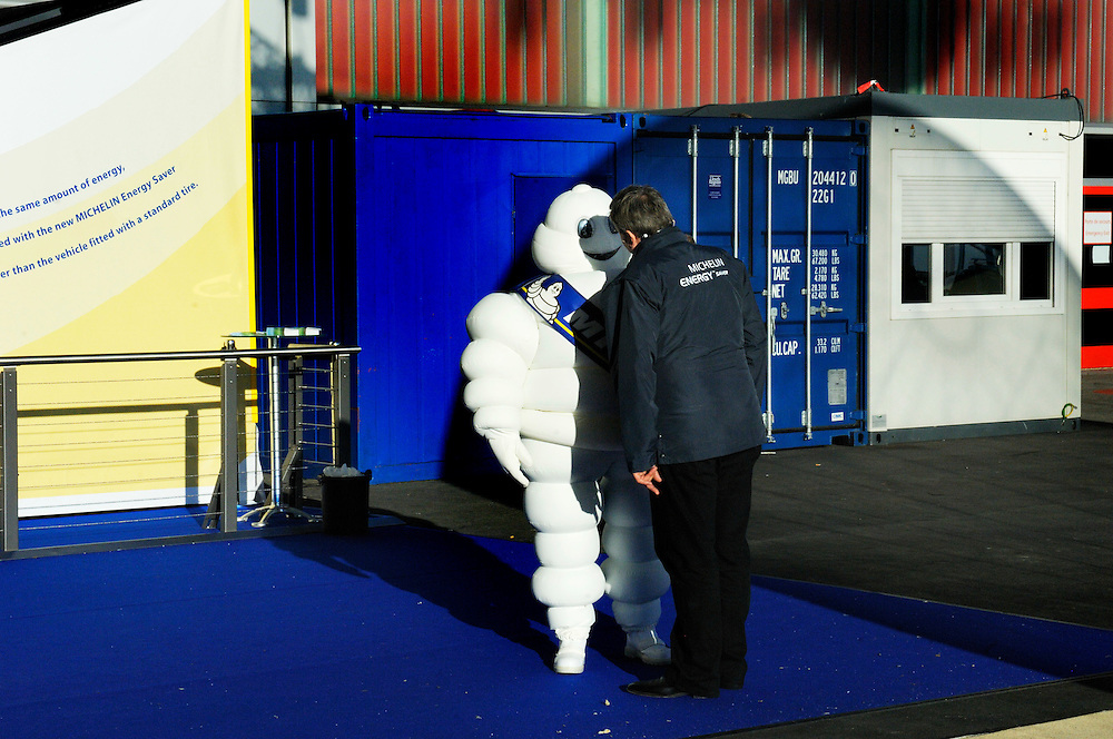 Michelin man being lectured by his boss at the Geneva Motor Show (Salon d'auto de Geneve), one of the most important rendezvous of the year for the car industry, and attended by all the major manufacturers.