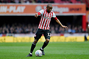 Brentford midfielder Kamohelo Mokotjo (12) *** during the EFL Sky Bet Championship match between Brentford and Queens Park Rangers at Griffin Park, London, England on 2 March 2019.