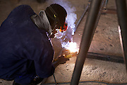 Students learning to weld at VETA college in Mtwara, Tanzania...VSO volunteer, Paul Burbidge, is working as a teacher trainer at the college to help improve training standards, with particular focus on the needs of the oil and gas industry.