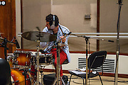 Havana, Cuba,December 18, 2014: Drummer Ruly Herrero is a master Cuban drummer. Jazz master singer, Bobby Kapp records at the Abdala Estudio in Havana. Gabriel Hernanez (red track suit) is the composer and producer.  12/16/2014 (Photo: Ann Summa).