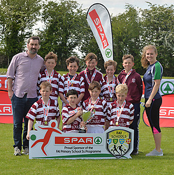 Scoil Iognaid Galway finalists in the SPAR FAI Primary Schools 5's Connacht finals, pictured at Solar Park Mayo with their C Cup and medals. As winners they will progress to the SPAR FAI Primary School 5's National Finals in the Aviva Stadium on May 31st.<br /> Pic Conor McKeown