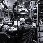 John Kovac, PI of the BICEP3 and BICEP Array projects, and Paula Crock at the computer console of the BICEP3 Telescope in the Dark Sector Lab.