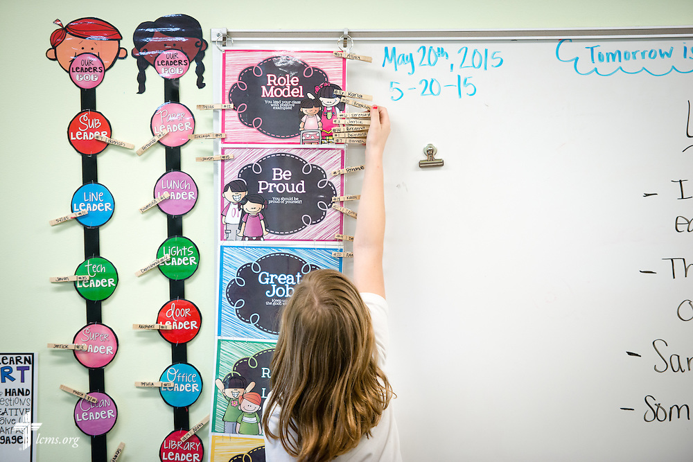 A student hangs her clothespin for achievement at the Renaissance School, part of Lutheran Urban Mission Initiative, Inc., on Wednesday, May 20, 2015, in Mt. Pleasant, Wis. LCMS Communications/Erik M. Lunsford