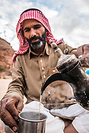 Sinai, Egypt, December 2018.  lead guide Musallam Abu Faraaj. Overnight camp and cooking at Ein Mileihis oasis, while hiking with the Tarabin Tribe through the Sinai Desert Coastal Ranges. The Sinai Trail is Egypt's 1st long distance hiking trail, running 230km from the Gulf of Aqaba to the top of the Sinai's highest mountain. It connects old trade, travel and pilgrimage routes through one of the Middle East's most iconic desert wildernesses and is managed by a cooperative of three Bedouin tribes. Photo by Frits Meyst / MeystPhoto.com