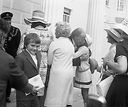 President Childers Inaugerated     (F26)..1973..25.06.1973..06.25.1973..25th June 1973..After his inaugeration President Childers returned to take up residence in Áras an Uachtaráin,Phoenix Park, Dublin..An informal picture of President and Mrs Childers being mobbed by their happy garndchildren. Nessa Childers ,the presidents daughter is in the background.