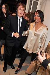 SIR PAUL McCARTNEY and DAME KELLY HOLMES at a party to celebrate the switching on of the Christmas Lights at the Stella McCartney store, Bruton Street, London on 29th November 2011.