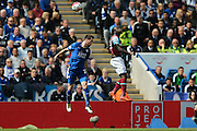 West Ham United midfielder, on loan from Chelsea, Victor Moses (20)   beats Leicester City defender Christian Fuchs (28)  to the header during the Barclays Premier League match between Leicester City and West Ham United at the King Power Stadium, Leicester, England on 17 April 2016. Photo by Simon Davies.