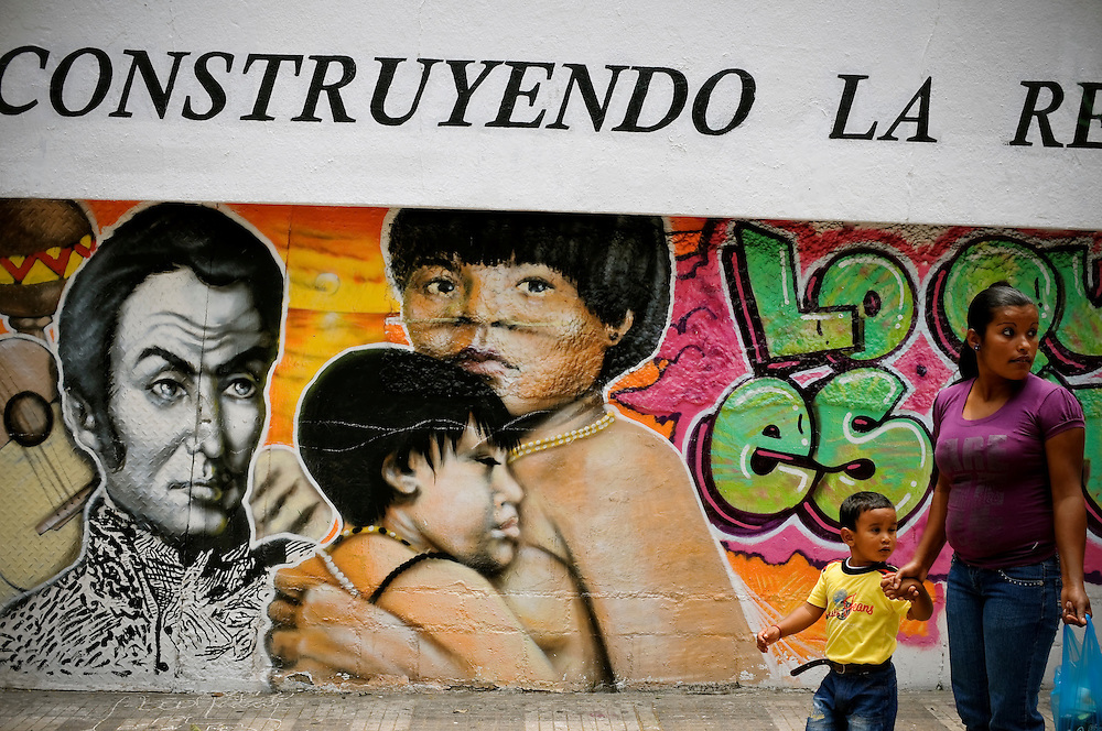 "A mural painted by Wildemar Liendo, ""Uki"", 23, of revolutionary leader Simon Bolivar and a Yanomami mother and her child in Caracas, Venezuela. The Venezuelan government commissions collectives of graffiti artists to plaster the city in murals and stencils that promote the Bolivarian revolution and the political agenda of President Hugo Chavez."