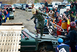 Annual Bilenky Junkyard Cyclocross & SSCXWC '13 Qualifier rounds - North Philadelphia, PA USA - December 7, 2013; A rider chooses to slide across the hood of a car rather than risk the 'big jump.'