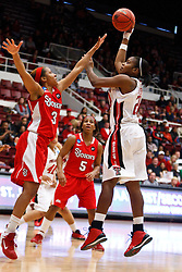 March 19, 2011; Stanford, CA, USA; Texas Tech Lady Raiders forward/center Kierra Mallard (20) shoots over St. John's Red Storm forward Da'Shena Stevens (3) during the first half of the first round of the 2011 NCAA women's basketball tournament at Maples Pavilion. St. John's defeated Texas Tech 55-50.
