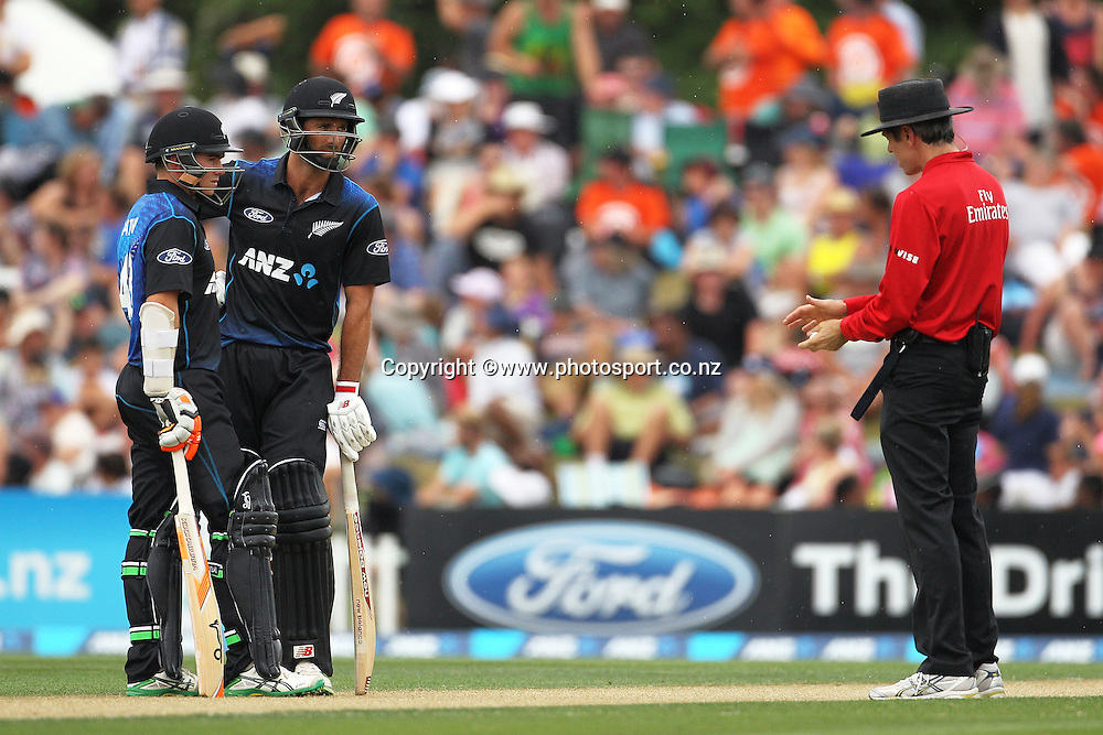Grant Elliott of the Black Caps and Tom Latham waiting for a decision during the first ODI cricket game between the Black Caps v Sri Lanka at Hagley Oval, Christchurch. 11 January 2015 Photo: Joseph Johnson / www.photosport.co.nz