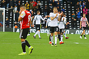 Derby County defender Craig Forsyth (3) applauds the Derby fans at the end of the game as Brentford forward Neal Maupay (9) is dejected during the EFL Sky Bet Championship match between Derby County and Brentford at the Pride Park, Derby, England on 22 September 2018.
