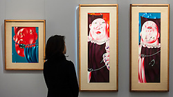 "© Licensed to London News Pictures. 25/11/2016. London, UK. A staff member views (L to R) ""Circus"" (est. GBP 50-70k) and ""Circus (Diptych)"" (est. GBP 80-120k), both by Oleg Tselkov, from the Bar-Gera Collection, at the preview of artworks from Sotheby's upcoming Russian sales in New Bond Street, where over three hundred works spanning several centuries will be offered. Photo credit : Stephen Chung/LNP"