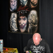 Matt K Tattoo tattoo a client at The Great British Tattoo Show, on 26 May 2019, London, UK.