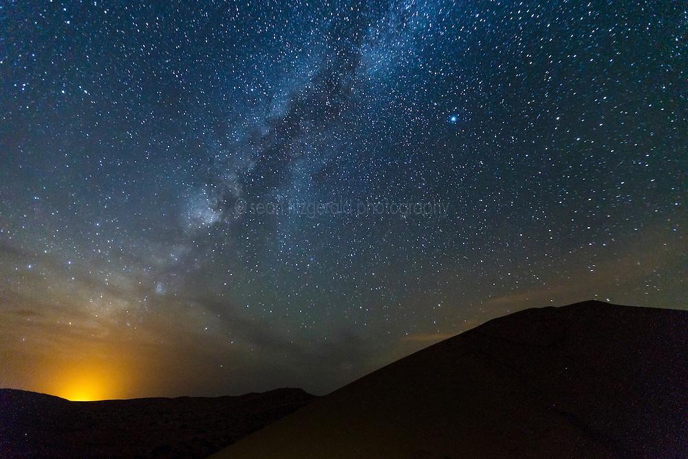 Stars and dunes at night. Erg Chebbi, Saharan Desert, Morocco