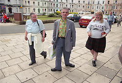 Group of people with learning disabilities walking together through seaside town,