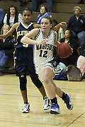 Caitlyn Ford drives past Fluvanna's Briana Burress during Madison's varsity basketball game with Fluvanna last week.  Madison lost to Fluvanna 50-37 but picked up a district win Saturday night defeating Clarke 43-38.  Caitlyn led the Mountaineers with 13 points in the Clarke game.  Date:  January/20/10, MCHS Varsity Girl's Basketball vs Fluvanna Flucos,