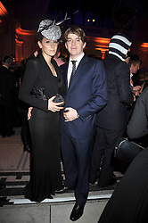The HON.ED TRYON and his wife NINA at Hats - an antology of Stephen Jones held at the V&A, London on 23rd February 2009.