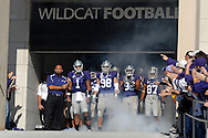 MANHATTAN, KS - NOVEMBER 17:  Head coach Ron Prince, left, along with quarterback Josh Freeman #1 and Linebacker Ian Campbell #98 of the Kansas State Wildcats get ready to take the field before a game against the Missouri Tigers on November 17, 2007 at Bill Snyder Stadium in Manhattan, Kansas.  Missouri won the game 49-32.  (Photo by Peter Aiken/Getty Images)