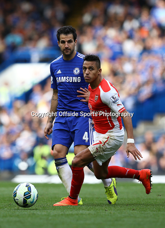 5 October 2014 - Barclays Premier League - Chelsea v Arsenal - Cesc Fabregas of Chelsea in action with Alexis Sanchez of Arsenal - Photo: Marc Atkins / Offside.