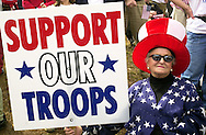"""VALLEY FORGE, PA - MARCH 16: Amelie Fretz, of Lansdale, Pennsylvania, holds a """"Support Our Troops"""" sign during a """"Rally for America,"""" March 16, 2003, in Valley Forge, Pennsylvania. Thousands of people attended the event to show their support for American troops readying for possible military conflict in Iraq. (Photo by William Thomas Cain/Getty Images)"""