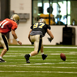 08 August 2009: Defensive end Jeff Charleston (97) and quarterback Mark Brunell (11) chase after a loose ball following a bad snap that resulted in a fumble recovery for the defense during the New Orleans Saints annual training camp Black and Gold scrimmage held at the team's indoor practice facility in Metairie, Louisiana.