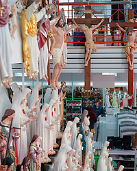 A souvenir shop in Fatima filled with replica statutes of the Madonna of Fatima, Jesus Christ crucified and other religious statuary.