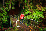 Hiker entering the Thurston Lava Tube, Hawaii Volcanoes National Park, Hawaii USA