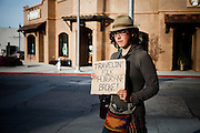 "Monterey, April 4 2012 - Stephanie, 22, a young Canadian woman hitch-hiking and beging for money, on her way from Canada to Mexico. She brought the novel ""On the Road"" by Jack Kerouac in her bag."