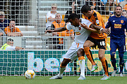 Tom Huddlestone battles with Conor Coady during the Sky Bet Championship match between Wolverhampton Wanderers and Hull City at Molineux, Wolverhampton, England on 16 August 2015. Photo by Alan Franklin.