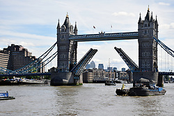 Tower Bridge opening for a yacht, River Thames, London UK
