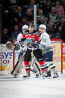 KELOWNA, CANADA - MARCH 18: Tyrell Goulbourne #12 of Kelowna Rockets is checked by Ethan Bear #25 of Seattle Thunderbirds on March 18, 2015 at Prospera Place in Kelowna, British Columbia, Canada.  (Photo by Marissa Baecker/Shoot the Breeze)  *** Local Caption *** Ethan Bear; Tyrell Goulbourne;