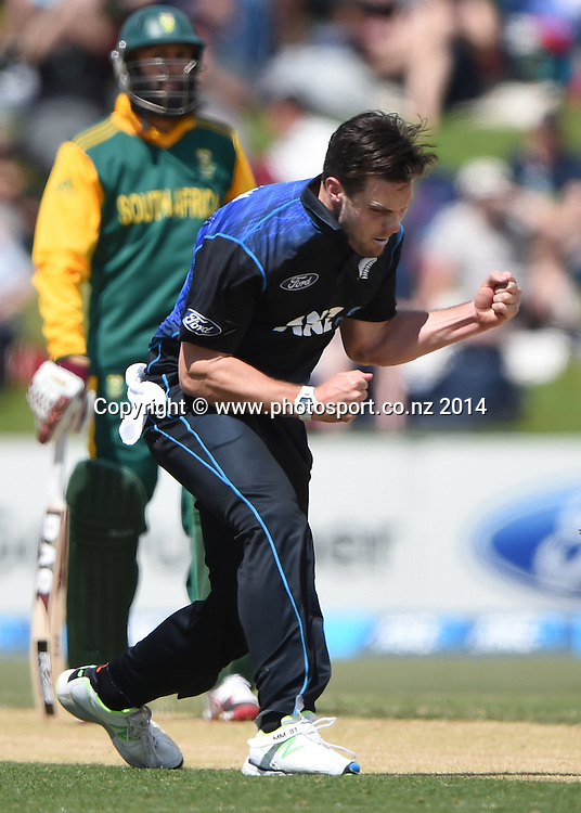 Mitchell McClenaghan celebrates the wicket of Quinton de Kock. ANZ One Day International Cricket Series between New Zealand Back Caps and South Africa, Bay Oval, Mount Maunganui, New Zealand. Friday 24 October 2014. Photo: Andrew Cornaga/www.Photosport.co.nz