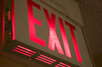 Blurred illuminated exit sign in motel interior