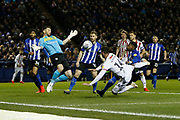 Sheffield Wednesday goalkeeper Keiren Westwood (1) saves from Sheffield United forward Gary Madine (14) during the EFL Sky Bet Championship match between Sheffield Wednesday and Sheffield United at Hillsborough, Sheffield, England on 4 March 2019.