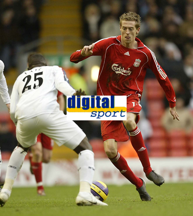 Photo: Aidan Ellis.<br /> Liverpool v Bolton Wanderers. The Barclays Premiership. 01/01/2007.<br /> Liverpool's Peter Crouch looks to take on Bolton's Abdoulaye Faye