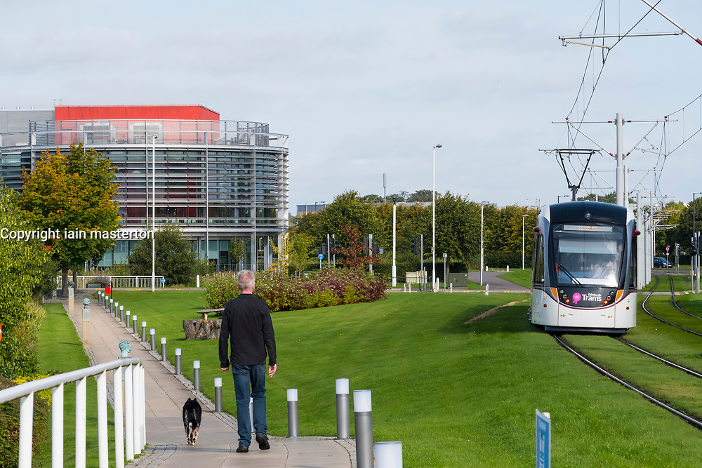 Tram and landscaped park at Edinburgh Park a modern business park at South Gyle in Edinburgh, Scotland, United Kingdom.