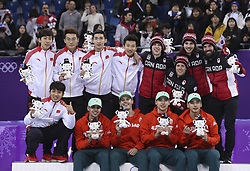 PYEONGCHANG, Feb. 22, 2018  Champion Team Hungary (in orange), second-placed team China (in white) and third-placed team Canada celebrate during venue ceremony of men's 5000m relay final of short track speed skating at the 2018 PyeongChang Winter Olympic Games at Gangneung Ice Arena, Gangneung, South Korea, Feb. 22, 2018. (Credit Image: © Han Yan/Xinhua via ZUMA Wire)