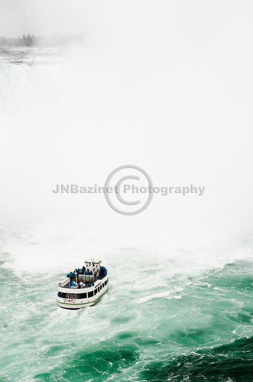 Tourist boat nears Horseshoe Falls in Niagara, Canada