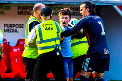 A young Birmingham City is escorted from the pitch by stewards - Mandatory by-line: Ryan Crockett/JMP - 22/04/2019 - FOOTBALL - Aesseal New York Stadium - Rotherham, England - Rotherham United v Birmingham City - Sky Bet Championship