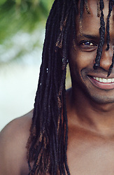 Smiling man with dreadlocks