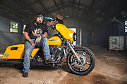 portrait of man on yellow motorcylce by Kevin Fuentes