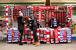 Arsenal fans shop for scarves at a stall outside the ground ahead of the Premier League match at the Emirates Stadium, London.