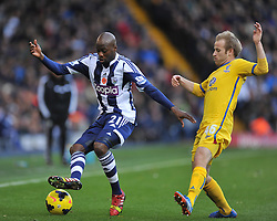 West Bromwich Albion's Youssuf Mulumbu shields the ball from Crystal Palace's Barry Bannan -Photo mandatory by-line: Alex James/JMP - Tel: Mobile: 07966 386802 02/11/2013 - SPORT - FOOTBALL - The Hawthorns - West Bromwich - West Bromwich Albion v Crystal Palace - Barclays Premier League